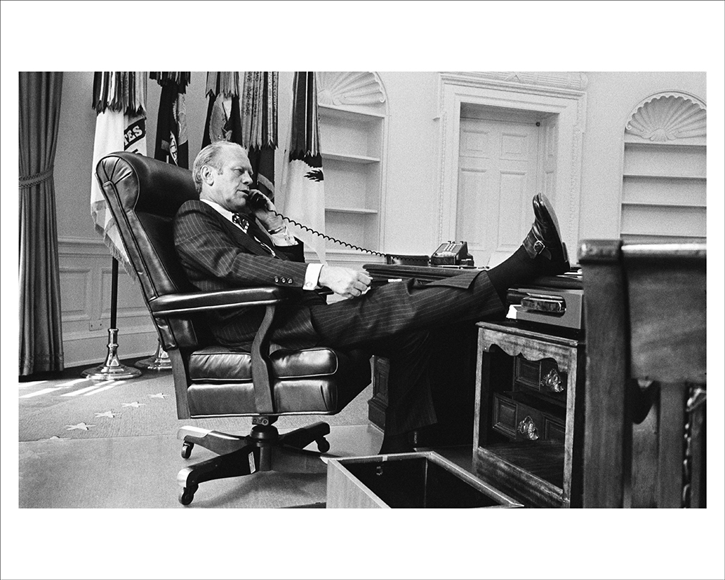 AUGUST 12, 1974  Gerald Ford gets down to business in an Oval Office recently emptied of President Nixon's personal effects, and not yet replaced by Ford's mementos. (Photo by David Hume Kennerly/Gerald R. Ford Presidential Library)