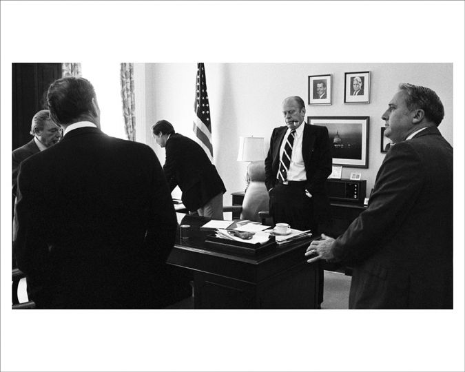 SEPTEMBER 8, 1974 Moments after he signed the pardon, President Ford and staffers met in the White House office of congressional liaison Bill Timmons to hear congressional reaction. Many of them privately said that he had done the right thing, but they would publicly condemn him for doing it. (L-R) Chief speechwriter Robert Hartmann, chief of staff Alexander Haig, Timmons, and counselor Jack Marsh. President Nixon's official portrait still hangs on the wall next to his vice presidential photo, another clue to the unusual and sudden transition of power. (Photo by David Hume Kennerly/Gerald R. Ford Presidential Library)