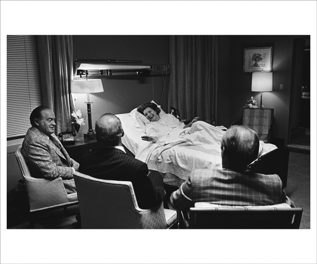 OCTOBER 5, 1975 Recovering from Surgery in the Presidential Suite of Bethesda Naval Medical Center, Mrs. Ford's spirits are lifted by a surprise visit from her husband and family friend Bob Hope. Mrs. Ford went public about her cancer operation against the advice of advisors. (Photo by David Hume Kennerly/Gerald R. Ford Presidential Library)