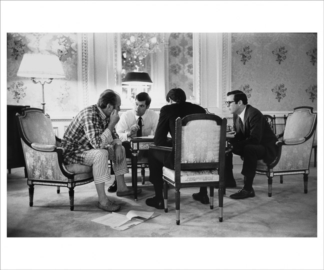 NOVEMBER 19, 1974 President Ford holds an informal early morning meeting in Tokyo's Akasaka Palace State Guest House with military aide Steve Todd, special assistant Terry O'Donnell, and chief of staff Donald Rumsfeld. Ford was the first sitting president to visit Japan. (Photo by David Hume Kennerly/Gerald R. Ford Presidential Library)