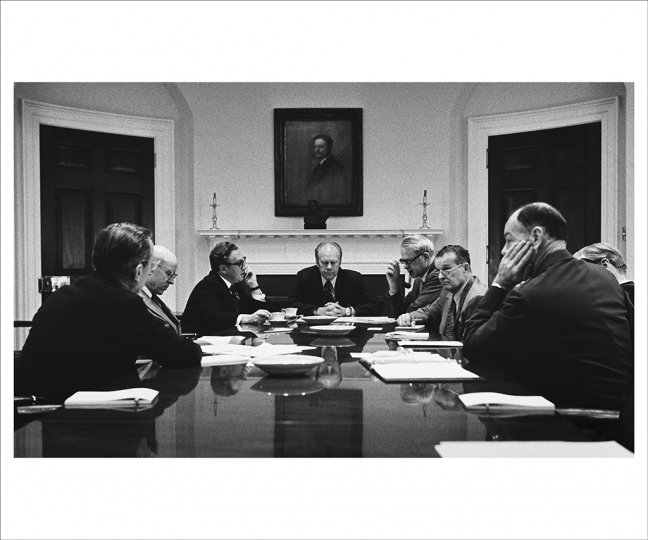 April 28, 1975 At a meeting of the National Security Council Ford makes the decision to evacuate Americans and many Vietnamese from Vietnam. (L-R), CIA Director William Colby, Deputy Secretary of State Robert Ingersoll, Secretary of State Henry Kissinger, Secretary of Defense James Schlesinger, Deputy Secretary of Defense Bill Clements, Vice President Nelson Rockefeller, and Chairman of the Joint Chiefs of Staff General George Brown. (Photo by David Hume Kennerly/Gerald R. Ford Presidential Library)