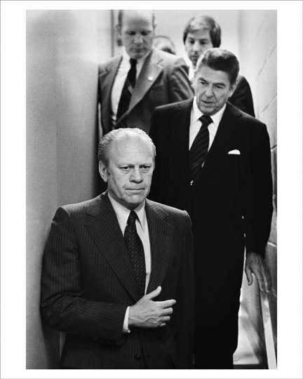 AUGUST 19, 1976 President Ford and Ronald Reagan make their way to a press briefing after Ford narrowly won his party's nomination by less than 200 votes at the 1976 Republican Convention in Kansas. Reagan had agreed to meet with the president only on the condition that Ford didn't ask him to be his vice president. This somber moment was what David Hume Kennerly documented behind the scenes, but moments later the public saw the two opponents smiling and complimenting each other at the press conference. (Photo by David Hume Kennerly/Gerald R. Ford Presidential Library)
