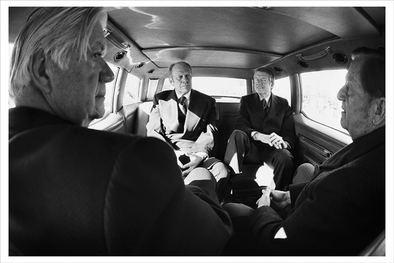 JANUARY 20, 1977 Sharing the presidential limousine on the ride from the White House to Capitol Hill for the inauguration of Jimmy Carter are President Ford, President-elect Carter, Senator Howard Cannon, and Speaker of the House Tip O'Neill. (Photo by David Hume Kennerly/Gerald R. Ford Presidential Library)