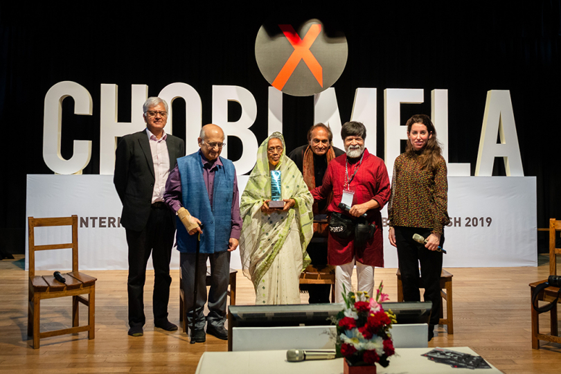 Impressions from the opening ceremony of Chobi Mela X at Chhayanaut Shangskriti Bhavan in Dhanmondi on 28th February 2019 in Dhaka, Bangladesh. On stage from left to right: Kunda Dixit (Editor, Himal Times) ; Prof. Rehman Sobhan (Economist and Chair of CPD); Festival director Shahidul Alam; Beth Citron (Rubin Museum) and photographer Raghu Rai Photo by Zakaria Hossain Shaqi / Chobi Mela X