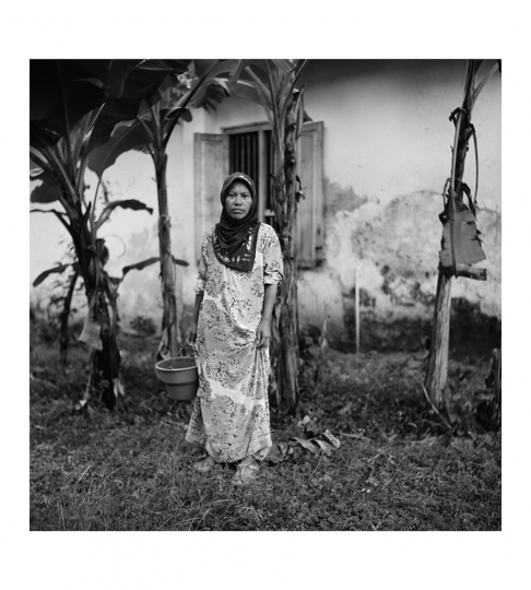 © Zhuang Wubin - 17 May 2015 / Longos, Gapura Sub District, Sumenep Regency, Madura Island, Indonesia Susmiyati (b. 1967, Longos) runs a small convenience store at Longos village. She lives in a house (in the background) that has been passed down by her Muslim grandfather Kwee Kee Sian (b. Longos; d. 1987). There is a Makam Keluarga (Family Cemetery) at Bintaro, Gapura, where Chinese of different religious faiths are buried in the same location. Kwee is also buried there.