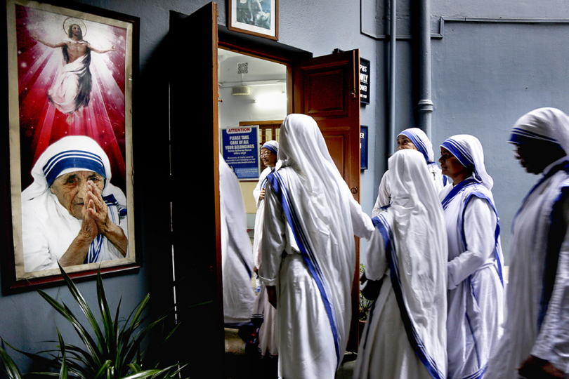Catholic nuns of the Missionaries of Charity, the order founded by Saint Teresa (picture left), arrive to join a prayer ceremony to mark the anniversary of her death in Kolkata, India, Tuesday, Sept. 5, 2017. The Nobel Peace Prize winning Catholic nun who spent 45-years serving for the poor, sick, orphaned, and dying, died in Kolkata on this day in 1997 at age 87.