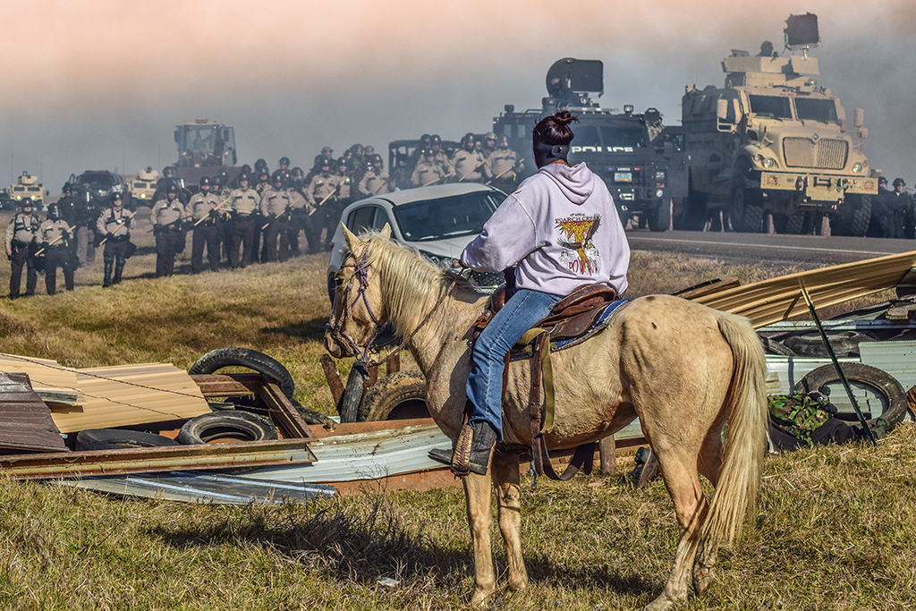 """Defend the Sacred"": Standing Rock, Cannon Ball, North Dakota, 2016 © Ryan Vizzions – Courtesy Monroe Gallery of Photography"