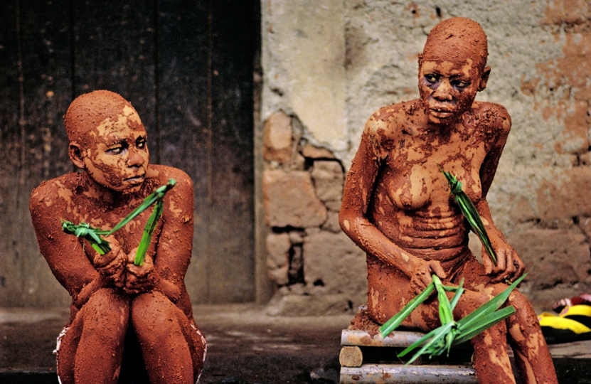 CAMEROON 1995 – These naked, mentally ill, patients are covered with earth. They have to stay like this every day for two hours until they are no longer 'possessed', helped by the magic utterances of the healer Tadoh Formantum of Bamenda. The earth is part of the treatment. © Pascal Maître
