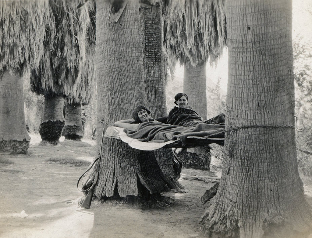 Susie Keef Smith and Lula Mae Graves lounge in hammocks at Corn Springs, 1930