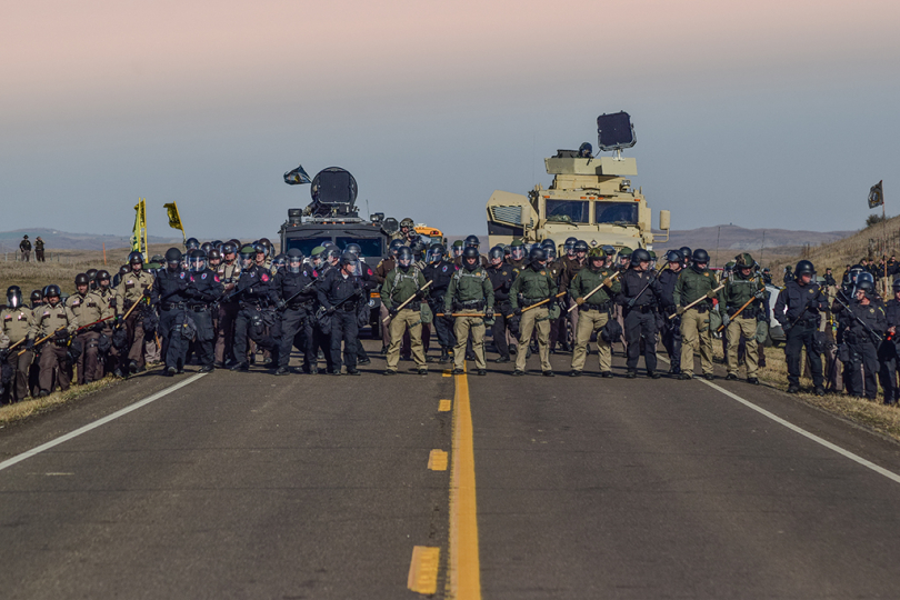 Police line during the sweep of Treaty Camp, north of the Standing Rock Sioux Reservation, October 27, 2016 © Ryan Vizzions – Courtesy Monroe Gallery of Photography