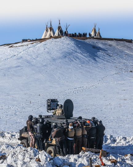 Protesters face off with police and the National Guard on February 1, 2017, near Cannon Ball, North Dakota © Ryan Vizzions – Courtesy Monroe Gallery of Photography