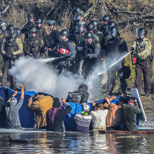 Native American Water Protectors attempt to gain access to Turtle Hill, where many of their ancestors are buried, to pray, Standing Rock, 2016 © Ryan Vizzions – Courtesy Monroe Gallery of Photography