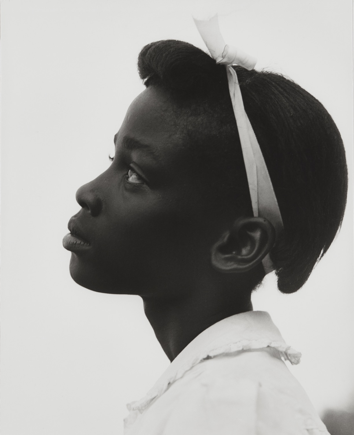 Consuelo Kanaga, Untitled (Profile of a Young Girl, from the Tennessee series), 1948 Gelatin silver print. 11 7/8 x 9 5/8 in. (30.2 x 24.4 cm) Credit stamp on the reverse of the mount. Image courtesy of Phillips. Estimate: $15,000-25,000 SOLD FOR $106,250