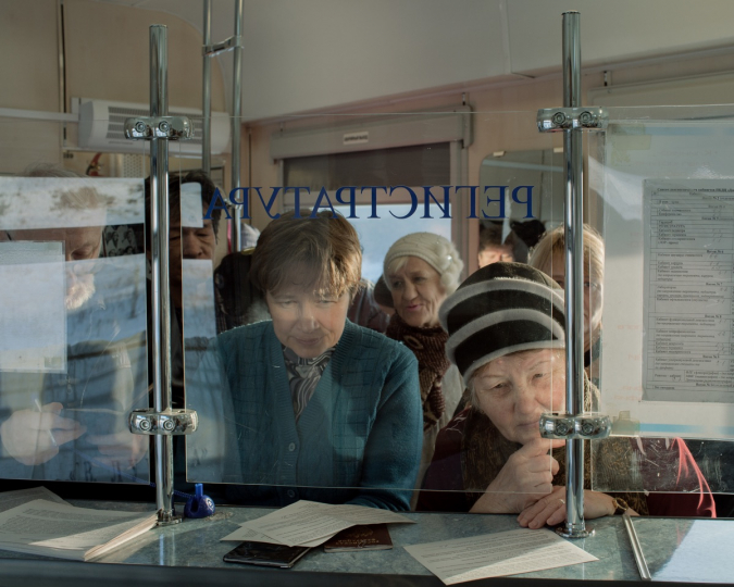 On board the medical train 'Saint Lukas' that travels to remote and underserved towns in Siberia. Patients register at the reception in the beginning of the train where they will be assigned to their treatment dates with the doctors. The treatments are free of charge. Son, Khakassia, Russia, 06.11.2016. © Emile Ducke