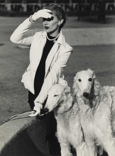 Lot 146: FRANCES MCLAUGHLIN-GILL (1919-2014) Lisa Fonssagrives with two white wolfhounds, for Vogue magazine. Estimate $2,000 - $3,000