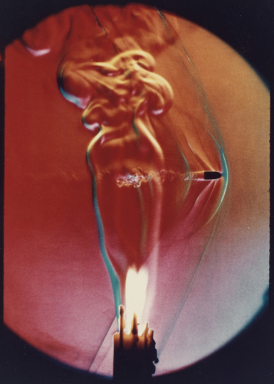 Lot 224: HAROLD EDGERTON (1903-1990) Bullet through candle flame. Estimate $2,000 - $3,000. - Courtesy Swann Auction Galleries