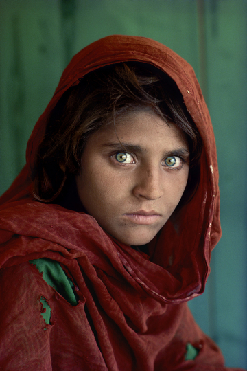 Sharbat Gula, Afghan Girl, at Nasir Bagh refugee camp near Peshawar, Pakistan, 1984. © Steve McCurry - Courtesy of Peter Fetterman Gallery
