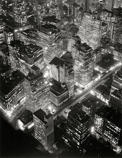 Berenice Abbott - Aerial view of New York by Night , March 20, 1936 58,4 × 45,7 cm International Center of Photography, Gift of Daniel, Richard, and Jonathan Logan, 1984 (786.1984).