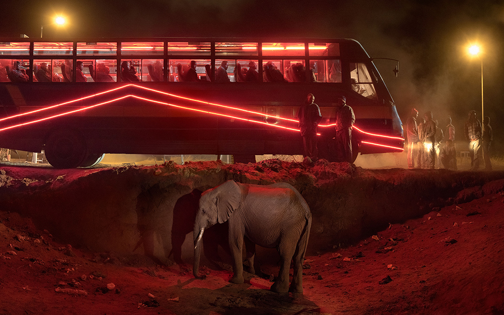 Nick Brandt Bus Station with Elephant & Red Bus 2018 Archival pigment print 56 x 89.6 in © Nick Brandt & Atlas Gallery
