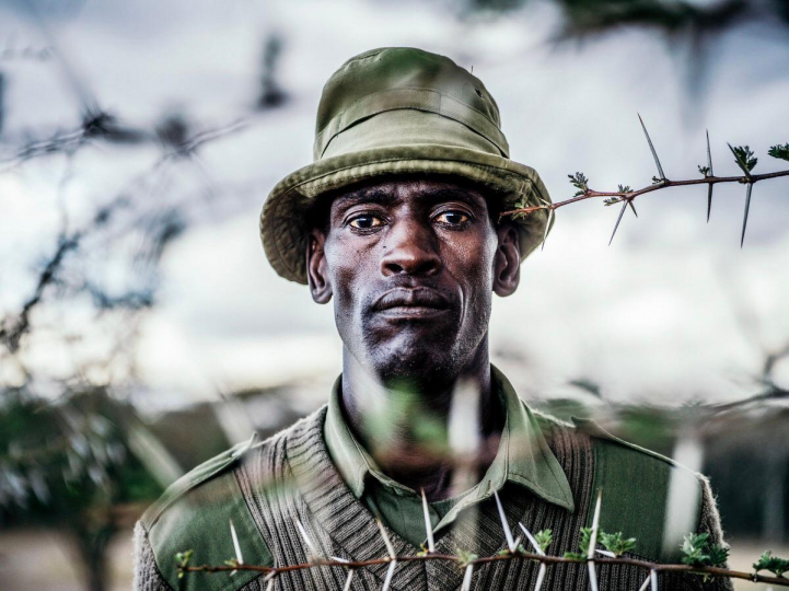 A portrait of Peter Esegon, 47, one of the primary caretakers of Fatu and Najin at Ol Pejeta conservancy in Central Kenya. Esegon has worked at the conservation for 20 years and his job entails looking after and educating visitors about the rhinos, 2018 © Justin Mott, courtesy Anastasia Photo, New York.