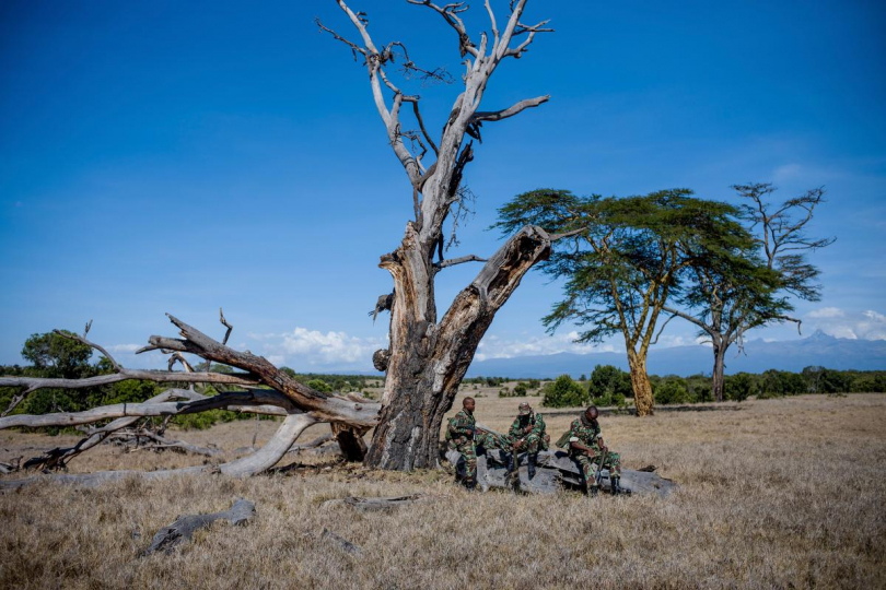 The NPR (National Police Reservists) take a small rest while on patrol looking for signs of poachers, 2018 © Justin Mott, courtesy Anastasia Photo, New York.