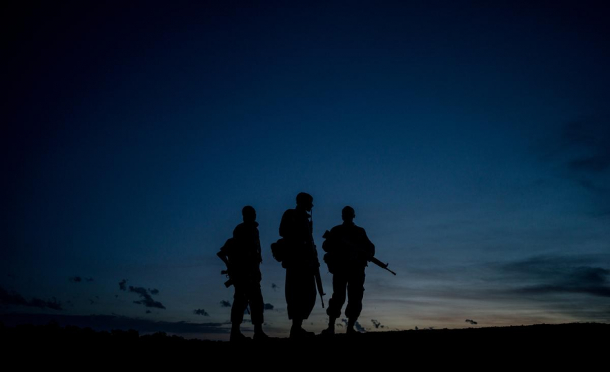 The NPR (National Police Reservists) patrol Ol Pejeta's 360 km2 (140 sq mi) conservancy around the clock, even camping overnight in the bush with their weapons protecting the grounds from poachers, 2018 © Justin Mott, courtesy Anastasia Photo, New York.