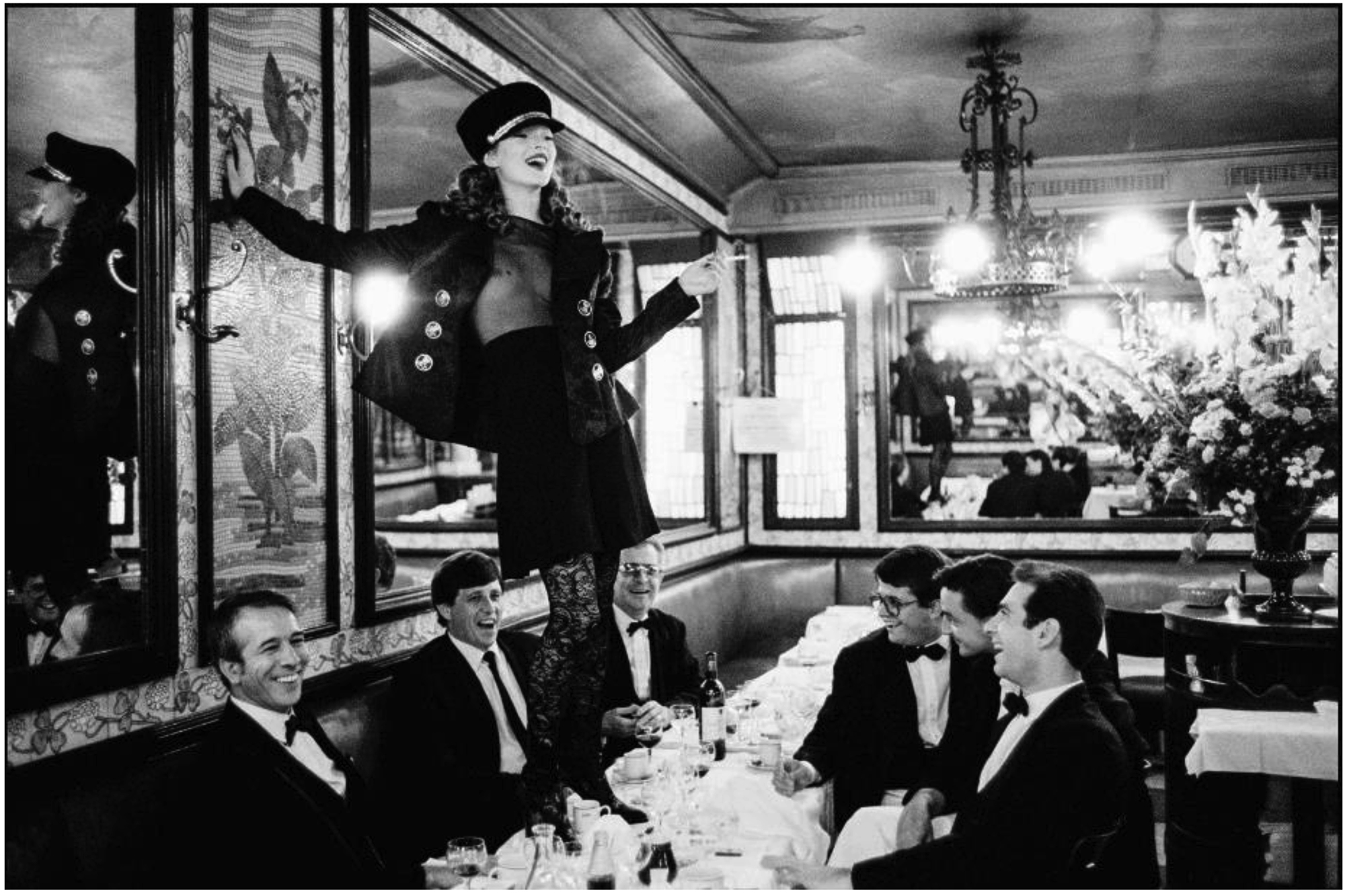 Arthur Elgort, Kate Moss at Cafe Lipp, Paris, Vogue Italia (1993). Image courtesy of the artist and Atlas Gallery