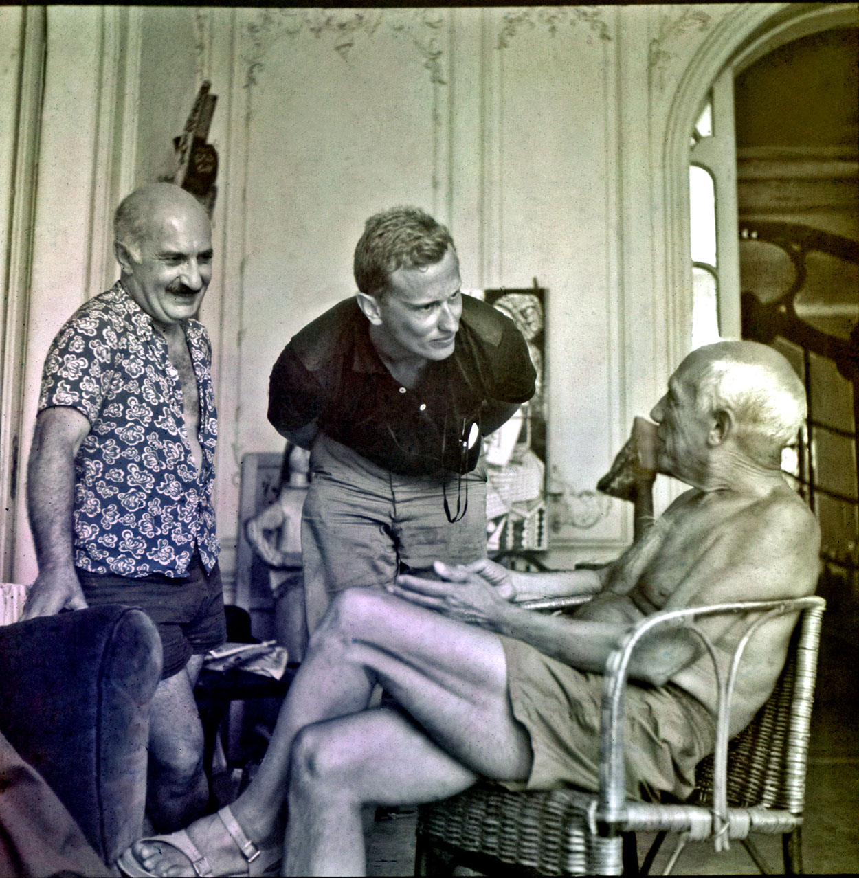 "Fred Baldwin (center) with Pablo Picasso, at the painter's home in Cannes, July 1955. ""In July 1955, I met Pablo Picasso.  I was a college student.  He was my imaginary father. I delivered an illustrated letter to his doorstep in Cannes explaining why I had to see him. I was scared to death, but it worked.  He was amused by my humor and tenacity and opened his door. I spent the day with him. It changed my life. After this experience, I felt that I could do anything I set out to do.  It became my Picasso mantra: 'You must have a dream, use your imagination, overcome your fear and act.' This set in motion much of what is described in this book.""  © Fred Baldwin"
