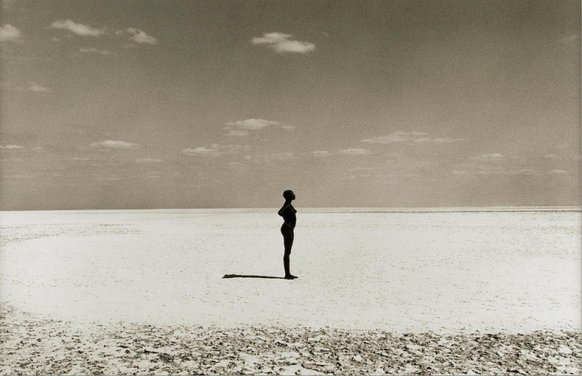 Herb Ritts (1952-2002) Malaika—Manyaca Salt Lake, Africa, 1993 Gelatin silver print, copyright credit blindstamp in the margin; signed, titled, dated and numbered '18/25' in pencil on the verso. 14 5/8 x 22 1/2in (37.1 x 57.2cm) sheet 20 x 24in (50.8 x 61cm) US$ 7,000 - 9,000£ 5,600 - 7,100 – Courtesy Bonhams