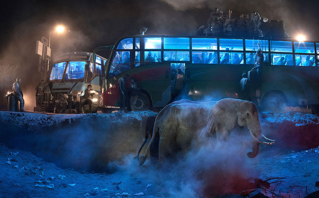 Nick Brandt, Bus Station With Elephant & Red Bus, 2018. © Nick Brandt Courtesy Edwynn Houk Gallery, New York