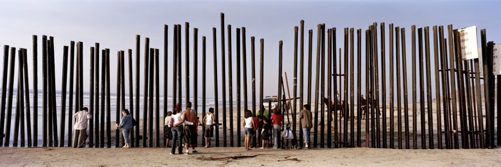 The very end of the Mexican-US border running into the Pacific Ocean in Tijuana, Mexico. November 2008. © Kai Wiedenhöfer