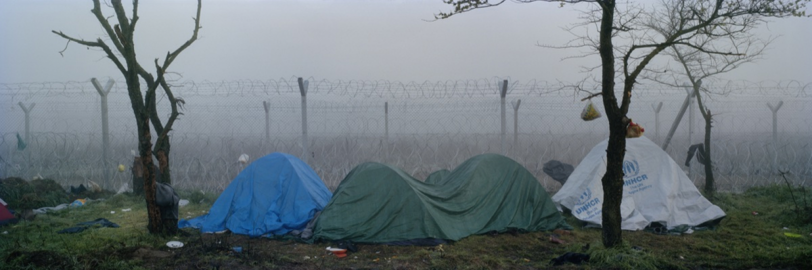 Tents of refugees in the early morning next to the Macedonian - Greek border in Idomeni, Greece. March 2016. © Kai Wiedenhöfer