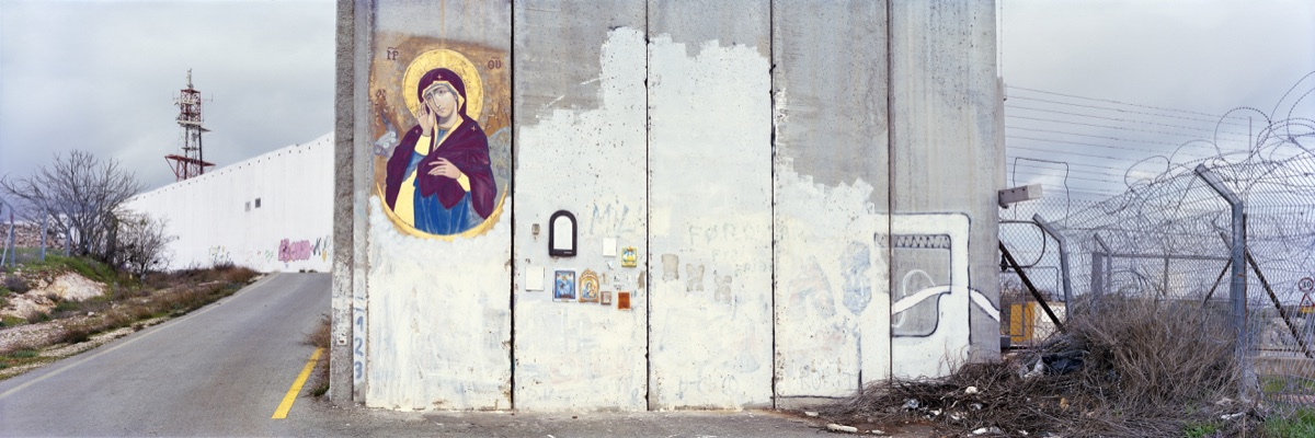 A madonna painted on the separation wall next to the entrance checkpoint of Bethlehem. Soldiers regulary erase graffity which is painted next to the checkpoint though the icon wasn´t painted over. Occupied Palestinain Territories, January 2018. © Kai Wiedenhöfer