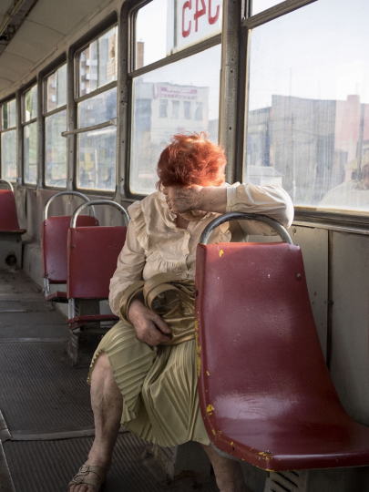 UKRAINE. Mariupol. May 27, 2015. A woman on the tramway downtown. Located on the Azov Sea, some 100 kilometers from the rebel-held provincial capital Donetsk, Mariupol is seen as a key element of a potential land corridor from Russia to the Crimean peninsula.© Jérôme Sessini / Magnum Photos